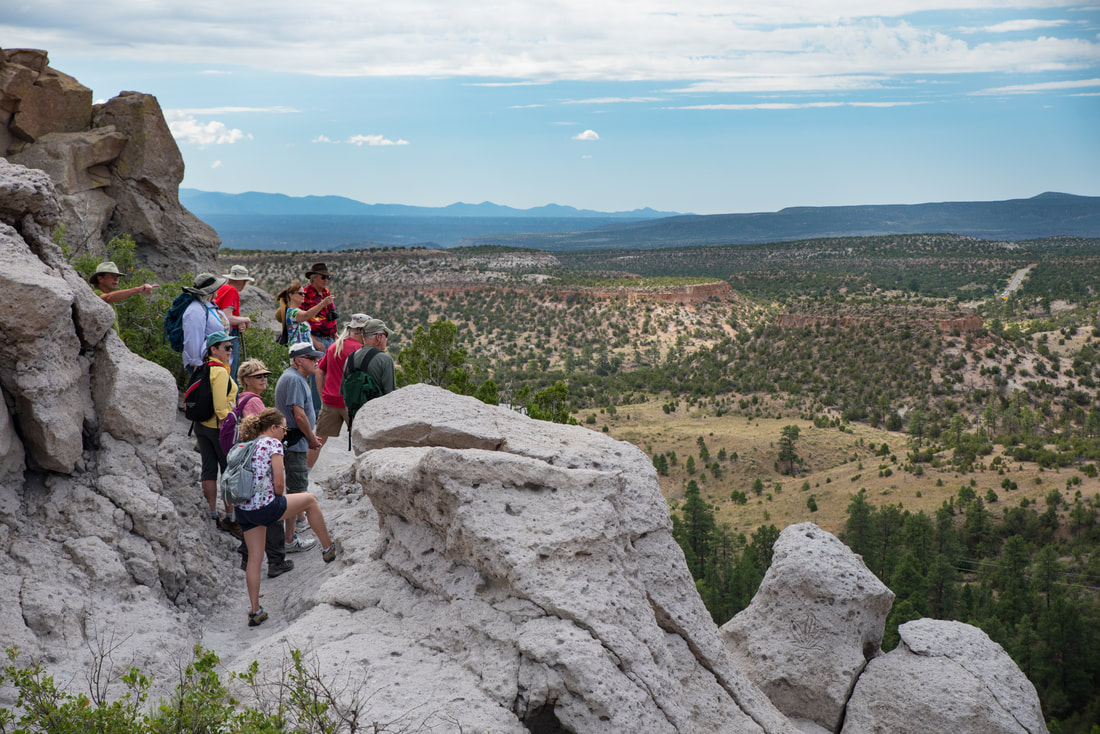 Photo of hikers at an overlook in Los Alamos
