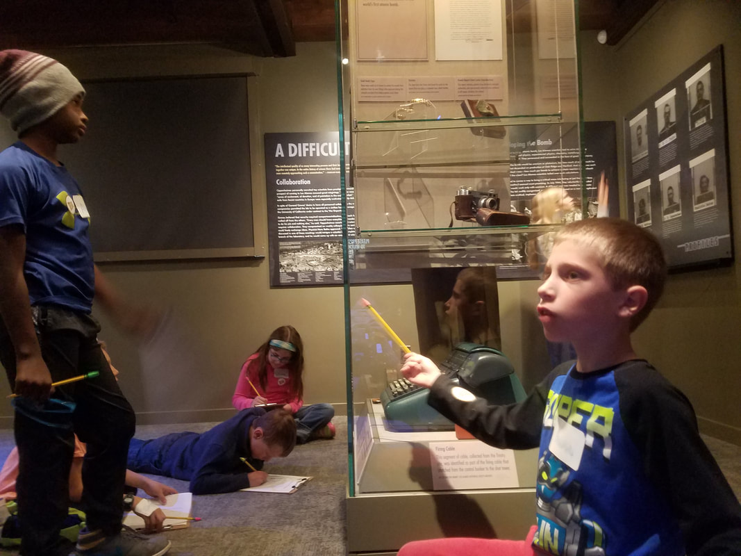 Students exploring the museum in the Time Travelers program.