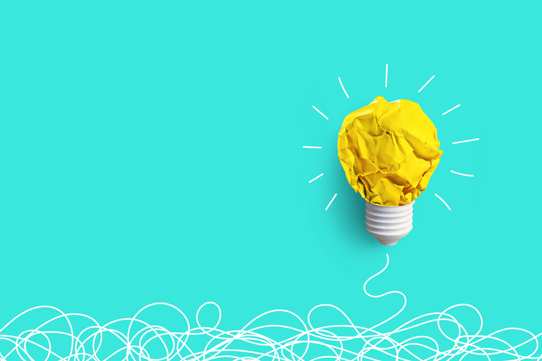 Lightbulb made from crumpled yellow paper