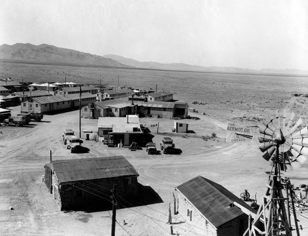 Base Camp at Trinity Site. Some of these buildings have been built for the test, others are from a ranch which was taken over by the government. Los Alamos Historical Society Photo Archives.