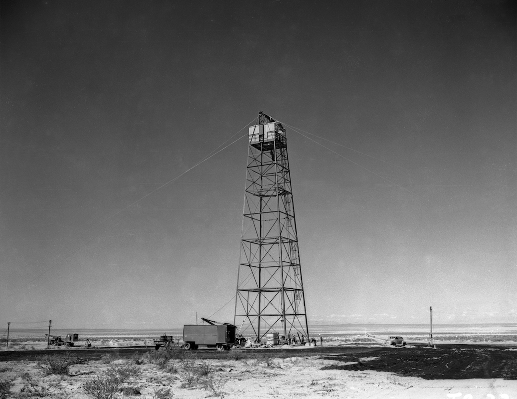 The Trinity Test tower under construction. In this photo people are working at the top and the base of the tower. Los Alamos Historical Society Photo Archives.